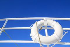 Boat buoy white hanged in railing summer blue sky. Boat buoy white hanged in railing summer vacation blue sky Royalty Free Stock Photography