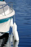 Boat with Buoys. Boat on water with buoys royalty free stock photos
