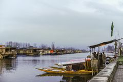 A boat call `Shikara` used by local people to travel cross the Dal Lake Royalty Free Stock Images