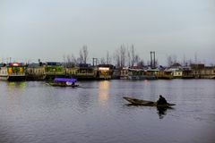 A boat call `Shikara` used by local people to travel cross the Dal Lake Royalty Free Stock Image