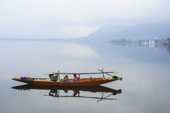 A boat called Shikara in Kashmir India. Boat is one of the important transportation at Dal Lake Srinagar India. It also become a famous tourist attraction in Royalty Free Stock Images