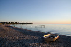 Boat at a calm bay Stock Photography