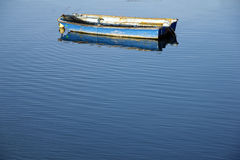 Boat and calm blue sea Royalty Free Stock Images