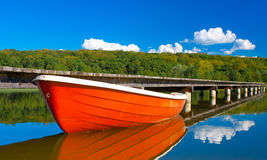 Boat in calm lake. Colorful boat in calm waters Stock Photography