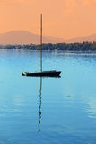 Boat on a calm lake Royalty Free Stock Photo