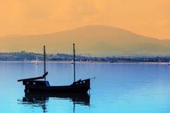 Boat on a calm lake Stock Photos