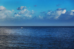 Boat in calm sea Stock Photos