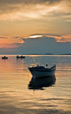 Boat on a calm sea at sunset in Sithonia. Greece Royalty Free Stock Photos