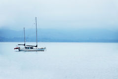 Boat on calm sea water Stock Images