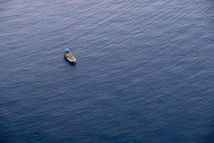 Boat on calm sea water near coast of Turkey Stock Image