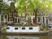 BOAT ON CANAL IN AMSTERDAM, HOLLAND Stock Image