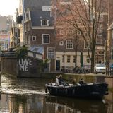 Boat on a canal in Amsterdam Netherlands. March 2015. Square format royalty free stock photos