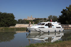 Boat at Canal du Midi in Beziers. Boat passing the Orb Aqueduct of the Canal du Midi in Beziers, France. Photo taken at 2nd of October 2011 Stock Image