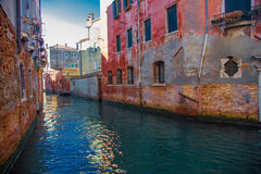 Boat on canal among houses. Venice, Italy. Royalty Free Stock Photos