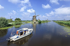 Boat in canal in Kinderdijk, Holland Royalty Free Stock Photography