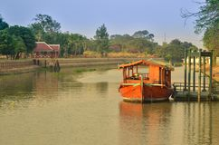 Boat in the canal. Old wooden boat parking at pier royalty free stock photography