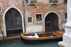 Boat in a canal in Venice royalty free stock photos