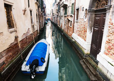 Boat on a canal of Venice, Italy Royalty Free Stock Photos