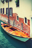 Boat on canal in Venice Stock Images