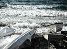 Boat and canoes at seaside Royalty Free Stock Photos