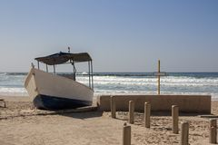 A boat with canopy is on the beach royalty free stock photography