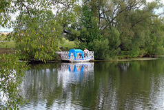 Boat with a canopy from the sun for swimming on the pond Royalty Free Stock Images