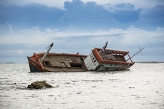Boat capsized. Sea danger rock Stock Photos