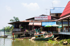 Boat capsized. View on bangnoi floating market early in the morning in Thailand on 20 April 2013 royalty free stock image