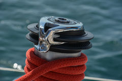 Boat capstan. Red rope and sea in the background Royalty Free Stock Images
