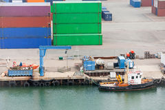 Boat in cargo port Royalty Free Stock Photography