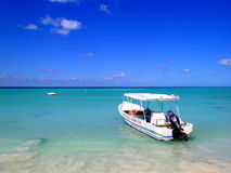 Boat on Caribbean. Boat moored off a beach in the Caribbean royalty free stock photos