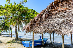 Boat on Caribbean beach, Guatemala Stock Photos
