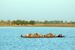 Boat carrying goods and people in Africa Royalty Free Stock Images