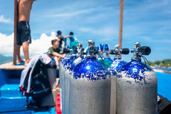 Boat carrying oxygen flasks for scuba diving Stock Images