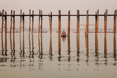 A boat carrying tourists on the lake in Mandalay, Myanmar Royalty Free Stock Photo