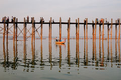 The boat carrying tourists on Taungthaman Lake, Mandalay, Myanmar Stock Image