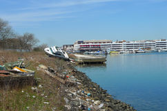 Boat cast ashore in the aftermath of Hurricane Sandy six months after storm in Brooklyn, NY Royalty Free Stock Photos