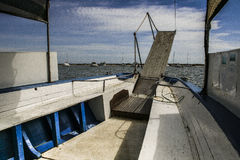 The boat. Catwalk Detail of a boat shuttle passengers to cross a river to the virgin beach Stock Images