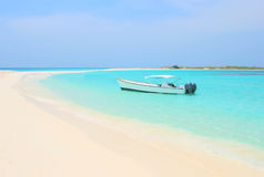 Boat at Cayo de Agua island. Boat at the tropical beach of Cayo de Agua island, Los Roques stock images