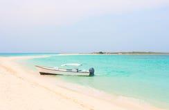 Boat at Cayo de Agua island. Boat at the tropical beach of Cayo de Agua island, Los Roques, Venezuela royalty free stock photo