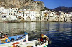 Boat in cefalu. Old town Cefalù in Sicily at summer and phishing boat stock images
