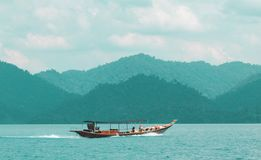 Boat on the Chao Lan Lake. A boat sailing on the Chao Lan Lake in Ban Ta Khun, Thailand Royalty Free Stock Photo