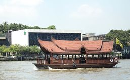 Boat at Chao Phraya river in Bangkok, Thailand. Wood. beautiful. Boat at Chao Phraya river in Bangkok, Thailand. The turists can use this boat to cros sthe city Stock Photo