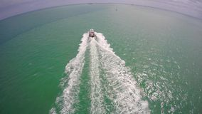 Boat chase Miami Beach stock video footage