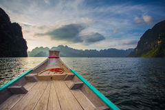 In boat. Chiewlarn dam in Sarat Thani Thailand. Traveler going to resort with boat. Relaxation among beautiful nature and fresh air stock image