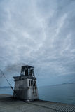 Boat chimney over cloudy sky Royalty Free Stock Photography