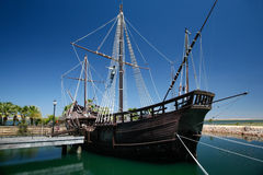Boat of Christopher Columbus. True sized replica of ancient boat named Pinta, one of the ships of Christopher Columbus when discovered America in 1492, docked at stock photos