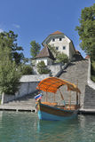 Boat and Church Assumption of Mary on lake Bled island Royalty Free Stock Photography