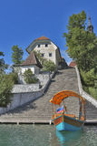 Boat and Church Assumption of Mary on lake Bled island Stock Photography