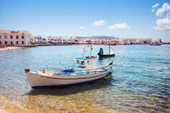 Boat with city of Mykonos, Greece. Royalty Free Stock Image